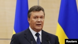 被推翻的乌克兰总统亚努科维奇在俄罗斯南部城市顿河畔罗斯托夫的记者会上发表声明。(2014年3月11日)