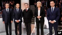 From left to right, Conservative presidential candidate Francois Fillon, Independent centrist presidential candidate for the presidential election Emmanuel Macron, Far-left presidential candidate for the presidential election Jean-Luc Melenchon, Far-right presidential candidate for the presidential election Marine Le Pen and Socialist candidate for the presidential election Benoit Hamon pose for a group photo prior to a television debate at French TV station TF1 in Aubervilliers, outside Paris, France, March 20, 2017.