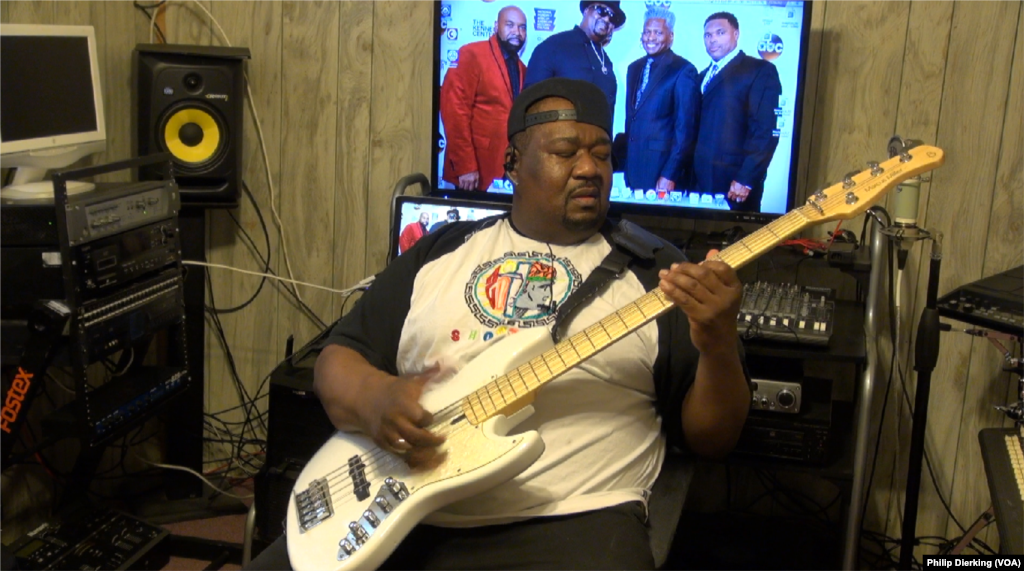 Big Tony Fisher demonstrating his skill on the bass guitar.