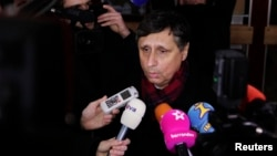 Candidate Jan Fischer speaks to the media after casting his vote in Prague, January 11, 2013.