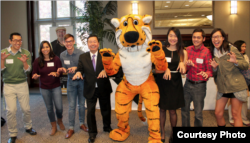 University of Missouri students stand with their school mascot, Truman the Tiger.
