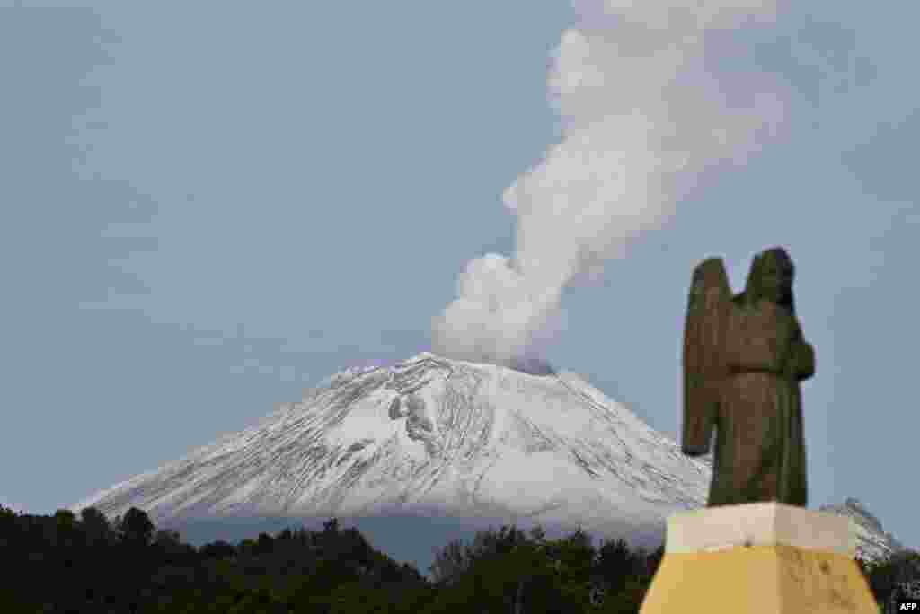 The Popocatepetl Volcano, Mexico's second highest peak just 55 km southeast of Mexico City, is seen from Santiago Xalitxintla, in Puebla - spewing a cloud of ash and smoke.