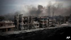 FILE - Smoke rises over Saif Al Dawla district, in Aleppo, Syria, Oct. 2, 2012.