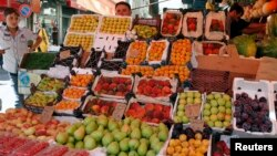 Fruits are displayed for sale at al-Shaalan market a day before the fasting month of Ramadan in Damascus, Syria, July 9, 2013.