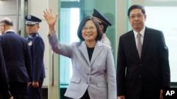 FILE - Taiwanese President Tsai Ing-wen waves to the media as she departs for Latin America at Taoyuan International Airport in Taoyuan, Taiwan, Aug. 12, 2018.