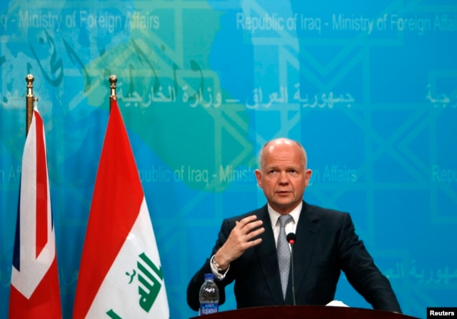 Britain's Foreign Secretary William Hague, who met with Iraq Prime Minister Nouri al-Maliki, speaks during a news conference in Baghdad, Iraq, June 26, 2014.