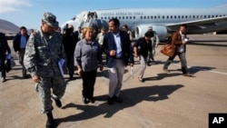 Chile's President Michelle Bachelet, center, arrives at the airport in Iquique, Chile, on April 2nd.