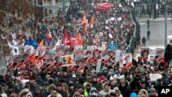 People march during a protest against Russia's new law banning Americans from adopting Russian children in Moscow, January 13, 2013.