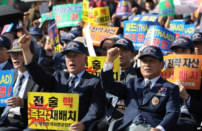 Members of the Korean Veterans Association shout slogans during a rally denouncing North Korea's nuclear and missile programs in Seoul, South Korea, Sept. 12, 2017.