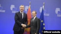 Crnogorski premijer Milo Đukanović i predsednik Evropskog saveta Donald Tusk tokom susreta u Briselu (rtcg.me)