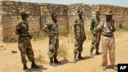 Ethiopian soldiers patrol in the town of Baidoa in Somalia, Feb. 29, 2012.