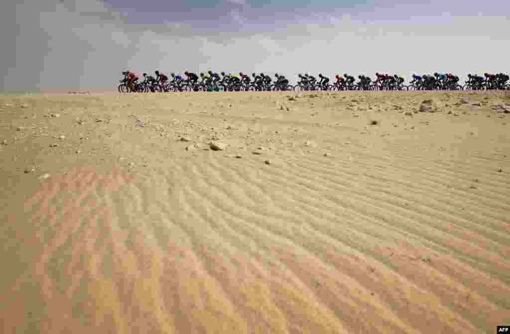 Bicyclists rides in the desert during the first part of the 2016 Tour of Qatar, between Dukhan and Al Khor Corniche.