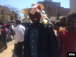 A protester with discarded bearers cheques.
