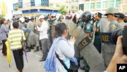 About 100 demonstrators gathered outside the court on Thursday, as the women were remanded to Prey Sar prison.