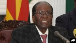 FILE: Zimbabwean President Robert Mugabe delivers a live speech to the nation, at State House, in Harare, Zimbabwe, Nov, 19, 2017. Mugabe baffled the country by ending his address without announcing his resignation.