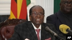 FILE - Robert Mugabe delivers a live speech to the nation, at State House, in Harare, Zimbabwe, Nov, 19, 2017. Mugabe baffled the country by ending his address without announcing his resignation.