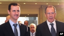 Prezida w'igihugu ca Syria, Bashar al-Assad ari kumwe n'umushikiranganji ajejwe imigenderanire w'Uburusia, Sergei Lavrov