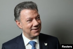 FILE - Colombian President Juan Manuel Santos poses for a portrait as he exits a Reuters Newsmaker conversation in Manhattan, New York, Sept. 21, 2016.