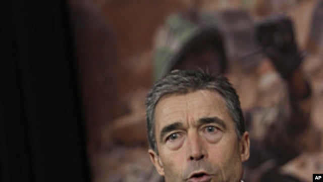 NATO Secretary-General Anders Fogh Rasmussen speaks during a media conference after a meeting of NATO defense ministers at NATO headquarters in Brussels on June 9, 2011.