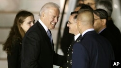 U.S. Vice President Joe Biden, second from left, shakes hands with U.S. Army Gen. Curtis Scaparrotti upon his arrival at Osan Air Base in Osan, South Korea, Dec. 5, 2013.