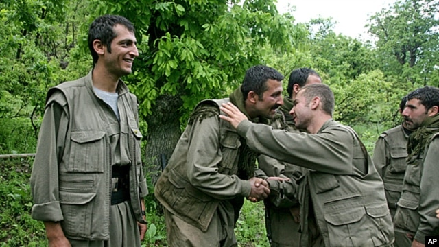 Kurdish fighters from the Kurdistan Workers Party (PKK) congratulate each other after arriving in the Heror area, northeast of Dahuk, 260 miles (430 kilometers) northwest of Baghdad,  May 14, 2013.