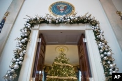 This year's White House Christmas Tree is seen inside the Blue Room. (AP Photo/Andrew Harnik)