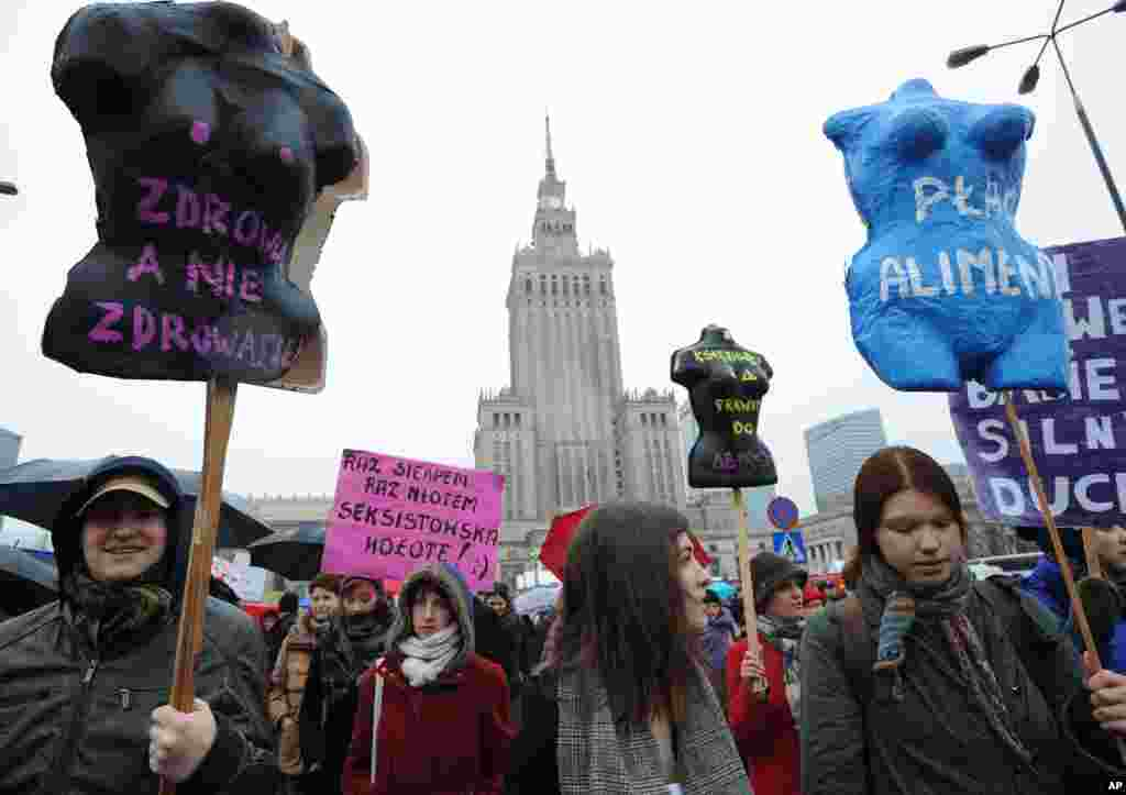 Protesters march demanding greater accessibility of abortion but also for better work conditions and more state support in raising children, in Warsaw, Poland, March 6, 2016.