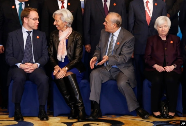 From left, Germany's Federal Bundesbank Jens Weidmann, IMF Managing Director Christine Lagarde, OECD Secretary-General Jose Angel Gurria and U.S. Federal Reserve Board Chair Janet Yellen take their seats for a family photo of G20 Finance Ministers and Central Bank Governors Meeting at the Pudong Shangri-la Hotel in Shanghai, Feb. 27, 2016.