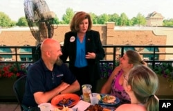 Republican Karen Handel campaigns at a restaurant in Johns Creek, Ga., June 16, 2017, ahead of a runoff election to replace former Representative Tom Price.