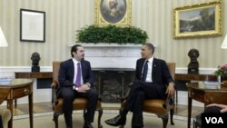 El primer ministro libanés Saad Hariri y el presidente Barack Obama se reunieron en la Sala Oval de la Casa Blanca, mientras en el Líbano renunciaba el gabinete.