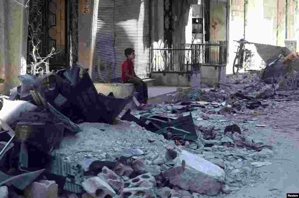 Dəməşqin Harasta rayonu döyüşlərdən sonra - 14 iyul, 2013