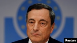 Mario Draghi, President of the European Central Bank (ECB) arrives for the ECB's monthly press conference in Frankfurt, Nov. 6, 2014.