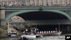 The royal barge Gloriana carries the Olympic flame along the river Thames, on the final day of the Torch Relay, London, July 27, 2012.