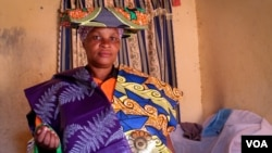 Charlotte Mapendo fled the DRC two years ago, and now supports her family by selling kitenge cloth door to door. June 24, 2014. (Hilary Heuler / VOA News)