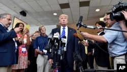 Republican presidential candidate Donald Trump speaks to supporters during a rally at the TD Convention Center, Aug. 27, 2015, in Greenville, S.C. (AP Photo/Richard Shiro)