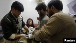 A girl who was injured during a rocket attack receives medical treatment at a hospital in Peshawar, Pakistan, Dec. 15, 2012.