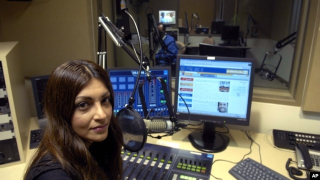 Radio Farda producer Sara Valinejad sits in the studio, Oct. 11, 2006, in Springfield, Virginia.