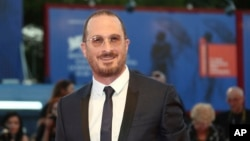 Director Darren Aronofsky poses for photographers at the premiere of the film 'mother!' at the 74th edition of the Venice Film Festival in Venice, Italy, Sept. 5, 2017.