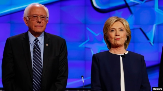 Democratic presidential candidate Senator Bernie Sanders and former Secretary of State Hillary Clinton stand together before the start of the first official Democratic candidates debate of the 2016 presidential campaign in Las Vegas, Nevada Oct. 13, 2015.