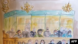 A courtroom sketch shows, from left to right, Ayoub El Khazzani, Mohamed Bakkali, Bilal Chatra and Redouane El Amrani Ezzerrifi sitting in the dock of the Paris Courthouse in Paris on Nov. 16, 2020.