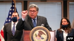 FILE-US Attorney General William Barr speaks on Operation Legend, the federal law enforcement operation, during a press conference in Chicago, Illinois, on September 9, 2020. (Photo by KAMIL KRZACZYNSKI / AFP)