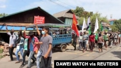 FIDemonstrators from the Dawei Technological University along with others march to protest against the military coup, in Dawei, Myanmar April 9, 2021 in this still image from a video. (Courtesy Dawei Watch/via Reuters)