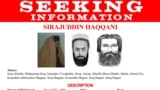 """FILE - Renderings of Sirajuddin Haqqani, head of the Taliban-allied Haqqani insurgent group, are seen on a fragment of a """"Wanted"""" poster issued by the U.S. Federal Bureau of Investigation. (Reuters/FBI/Handout)"""