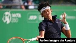 On June 8, 2021, China's Zhizhen Zhang returns a shot from Italy's Andreas Seppi during early round action of the Nottingham Open in Nottingham, Britain.