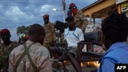 FILE - A young man is arrested by police during a curfew in Juba, South Sudan, April 9, 2020.