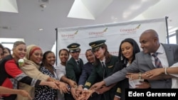 An all-female flight crew from Ethiopian Airlines celebrates at Washington Dulles International Airport after arriving from Addis Ababa, March 8, 2020 (Eden Geremew/VOA)