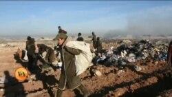 کچرے میں روزگار تلاش کرتے عراقی بچے