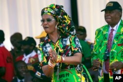FILE: Zimbabwean First Lady Grace Mugabe dances at a rally in Gweru, Zimbabwe, Friday, Sept, 1, 2017.