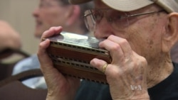 97-Year-Old Credits Harmonica as Key to Long Life
