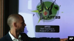 Alister Shepherd, the director of a subsidiary of the cybersecurity firm FireEye, gestures during a presentation about the APT33 hacking group, which his firm suspects are Iranian government-aligned hackers, in Dubai, United Arab Emirates, Tuesday,…